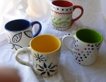four artists made one mug each