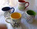 four artists made one mug each